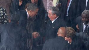 President Obama and Cuban Leader Raul Castro Shaking Hand at Nelson Mandela's Funeral (file photo)